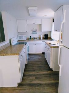 Kitchen with stove, microwave, dishwasher, drip coffee and Keurig coffee maker
