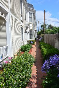 Walk down the flower lined path to Unit 3.