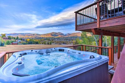 Soak up the incredible views while you soak sore quads in the private hot tub!