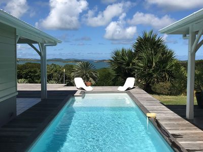 Photo for VILLA DESIGN IN THE CAPE EST FRANCIS WITH PANORAMIC VIEW ON THE LAGON AND THE ILETS