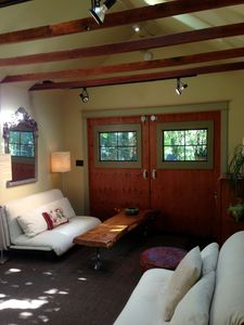 view of the carriage doors and the two futon sofa-beds.