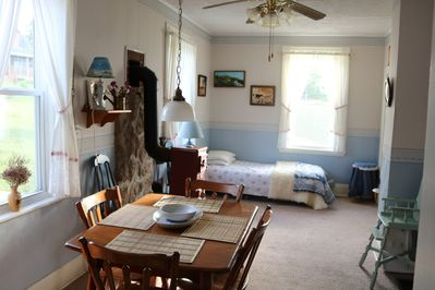 Dining area, decorative stove, & day bed