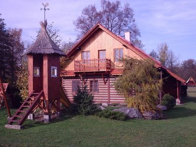 Photo for Holiday house with wood-burning fireplace and children's playground