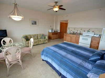 Spacious and stylish oceanfront efficiency condo with WiFi and an outdoor pool located uptown just steps to the beach!