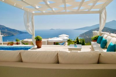 Seated pergola by the pool with wonderful view