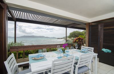 Photo for Sapphire Beach Condo, on the beach living. Views of St John and BVI