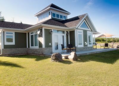 Photo for 3 bedroom 2.5 bath property  located in Baddeck on the Bell Bay Golf Course