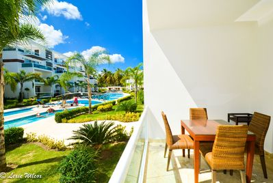 Amazing View of Pool! Relax in the Breeze on the Front Terrace off Living room.