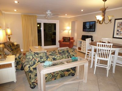 SPACIOUS LIVING & DINING ROOM AREA. UPGRADED SLIDING GLASS DOOR IN THIS CONDO.