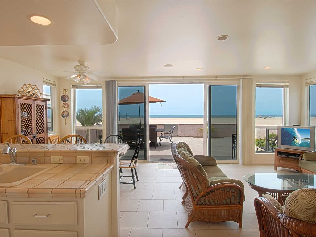 Lovely lower unit with spectacular oversized patio right on the sand!