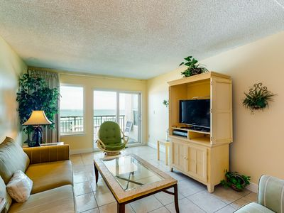 Photo for NEW LISTING! Beachfront home with private balcony, shared pool, & beach access!