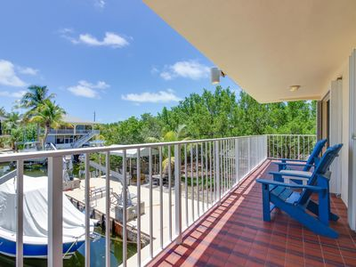 Photo for Bayfront condo w/ balcony, covered deck, shared enclosed yard and dock