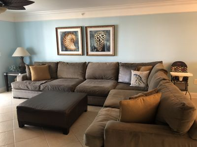 Large oversized sectional in living room area.