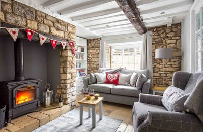 Photo for Miller's Cottage is one of a row of traditional Cotswold stone cottages in the heart of Winchcombe