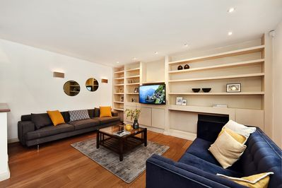 The bright and elegant living room with lounge, dining table for 6 and kitchen