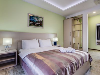 Photo for Deluxe Room with Balcony Steps from the Sea