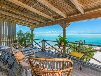 Photo for Upstairs apartment on the beach with views over the Bonefish flats