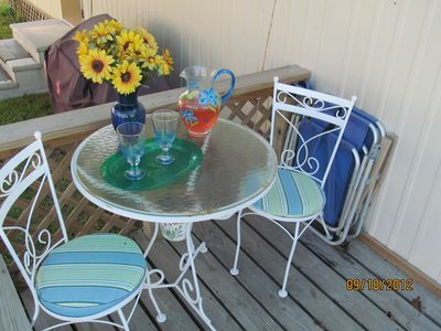 Enjoy a cold drink after the beach on your private deck.