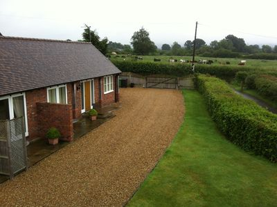 Photo for WISTERIA COTTAGE 'A' QUITE COTTAGE WITH STUNNING VIEWS OF SHROPSHIRE HILLS