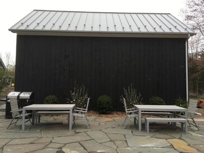 bluestone patio with (2) 6 person dining sets