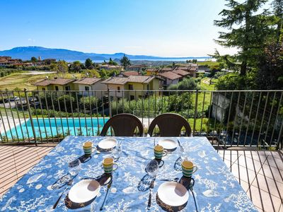 Photo for Pegaso: with lake view balcony, pool and private garge