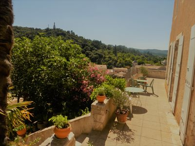 Photo for Medieval house, terrace in the sun, shady enclosed garden, swimming pool