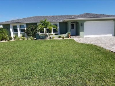 Photo for Updated Serene PGI Canal Home with Heated Saltwater Pool and Dock