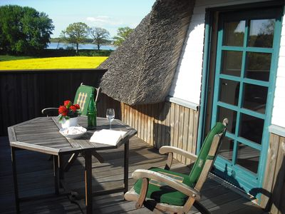 Photo for Holiday under the thatched roof overlooking the water