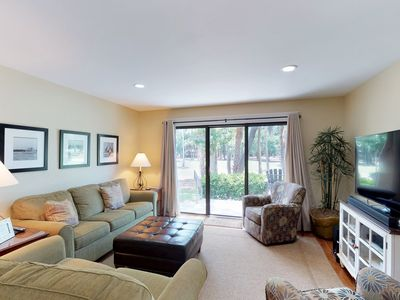 Photo for Elegant townhouse w/ shared pool & private patio - steps to the golf course!
