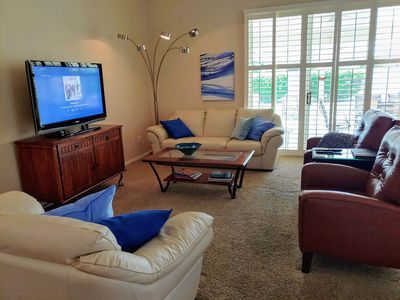 Comfortable living room with lots of bright light!