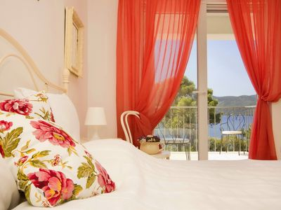 Photo for Let the waves wake you up and take a swim in private pool at the beachfront villa