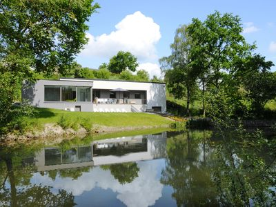 Photo for Modern villa with indoor swimming pool, in the middle of the Noiseaux nature