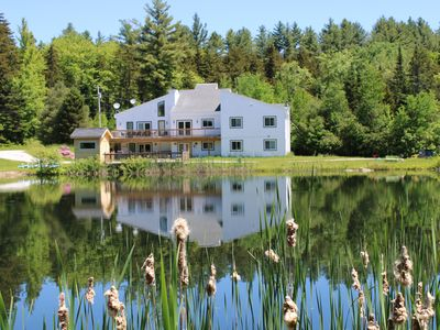 Photo for 9 Br Gorgeous Estate with Private Lake, Hot Tub, Sauna - Sleeps 24
