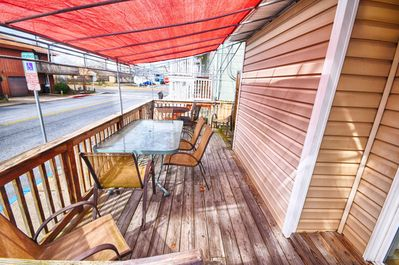 1 level rancher with covered deck for relaxing and people watching.