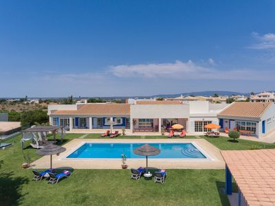 Photo for This 4-bedroom villa for up to 8 guests is located in Alvor and has a private swimming pool and Wi-F