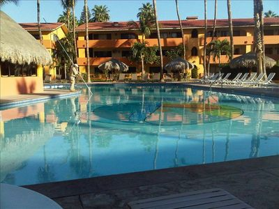 Quiet & peaceful Oasis pool with bar/restaurant service and happy hour.