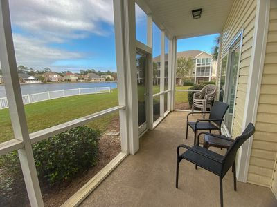 Photo for Walking distance to beach. 3 bedroom, 2 bath condo. Lake view. Sleeps 10.  Outdoor pool, jacuzzi, fitness room.  No pets.  No motorcycles.