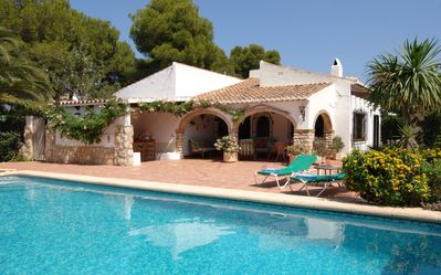 Tranquil Villa Trencall by the large floodlit pool.professionally tended gardens
