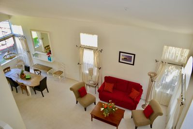 The living room is full of natural light and adjacent to the dining room.
