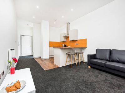 Photo for 1BR Flat with great WiFi next to the Station!