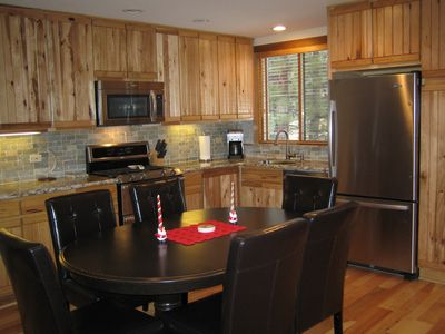 Kitchen with all new stainless steel appliances and expandable table to seat 8.