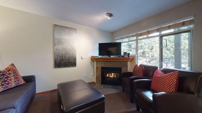 This ground level condo features an open plan living / dining / kitchen and gas fireplace