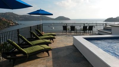 Photo for Penthouse with amazing views of the bay & city with large private dipping pool
