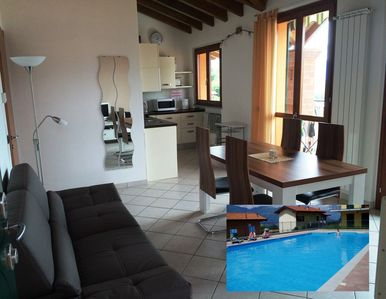 Photo for Quiet holiday resort, fantastic lake views, solar heated pool, WiFi