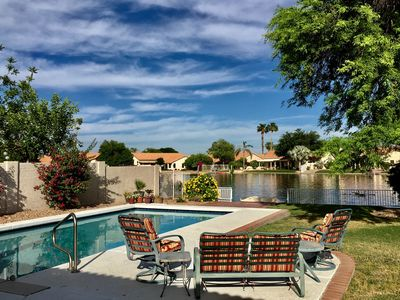 Private lakefront backyard with pool
