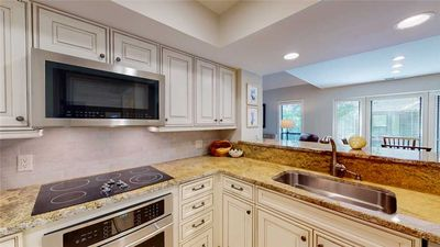 Photo for Fully renovated condo with views of the 11 mile lagoon system!
