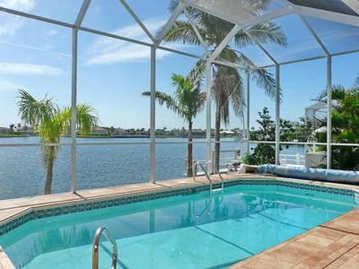 Photo for Waterfront house with mesmerizing views, heated pool and walk to beach