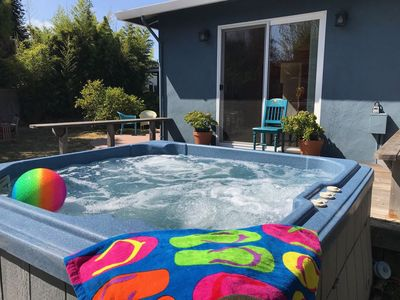 Photo for Steps to the Beach... with Hot Tub!