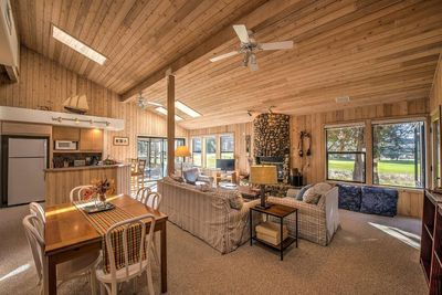 Modern rustic living and dining area with cabin decor