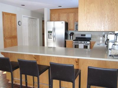 Spacious kitchen with counter seating for 4